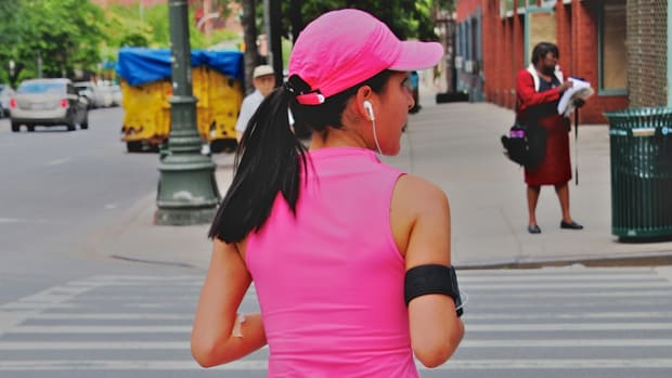 women in pink exercising photo