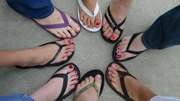 Circle of pedicured feet