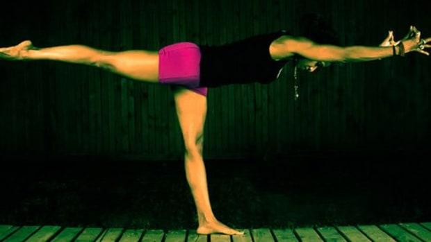 Woman balancing yoga