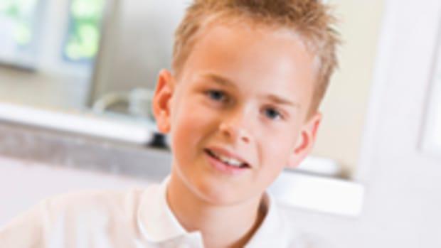 Schoolboy enjoying his lunch in a school cafeteria