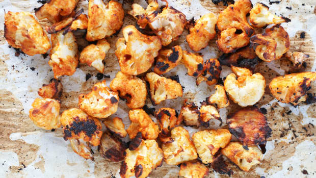cauliflower hot wings on parchment paper