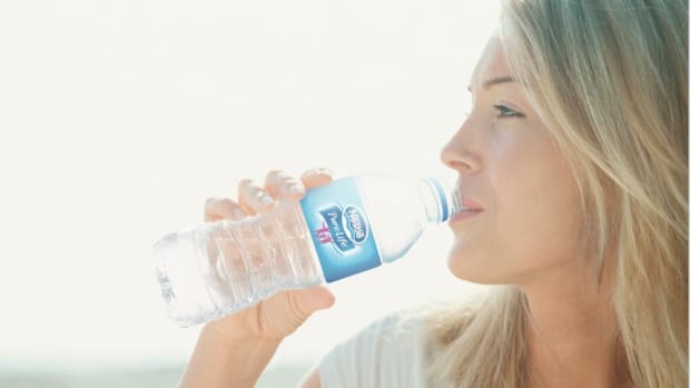 nestle-pure-life_drinking_caucasian_woman_outdoor_water_consumption copy