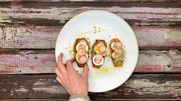 sweet potato toast with egg radish and a hand reaching in