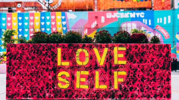 Love self on a city planter.