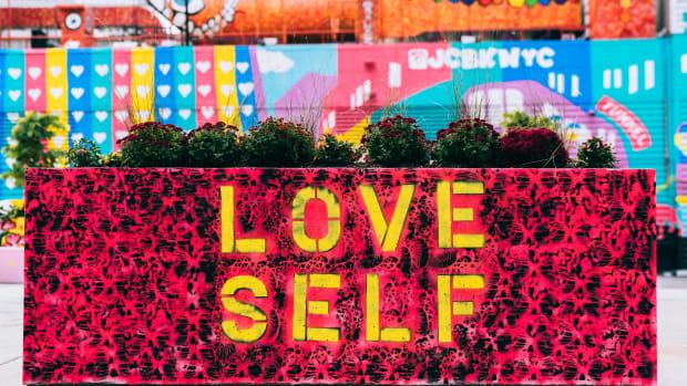 Love self on a city planter.