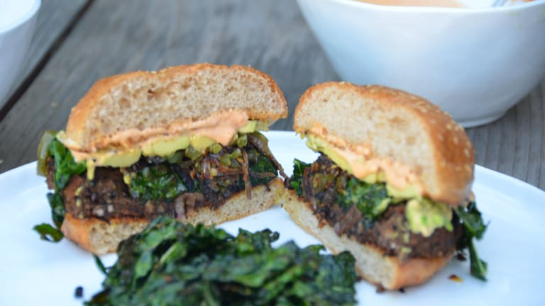 Black Bean Quinoa Burger with Caramelized Onions, Jalapeños, Avocado, and Blistered Kale [Vegetarian]