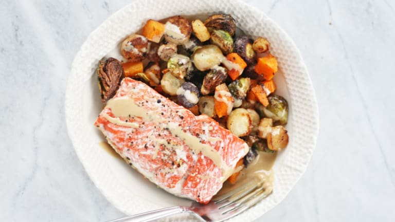 Winter Vegetables and Salmon One-Pan Dinner With (Heavenly) Maple-Tahini Dressing