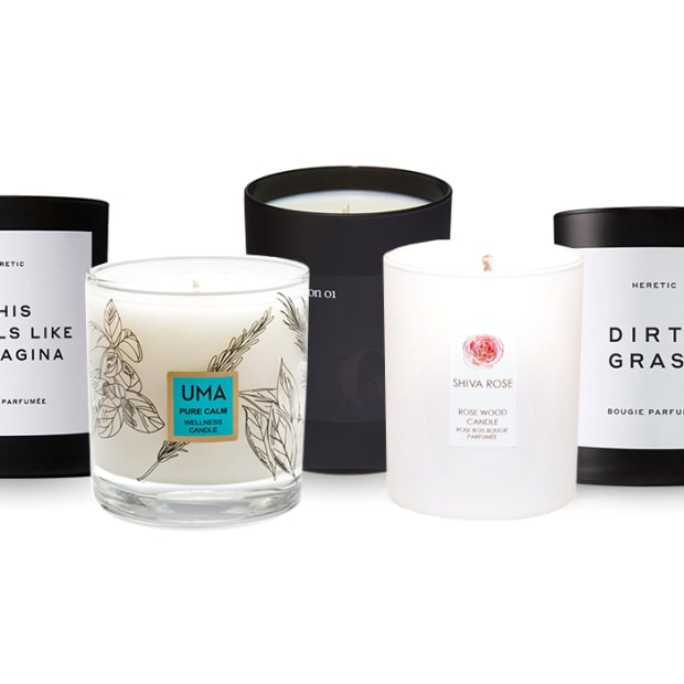 5 non toxic candles against a white background