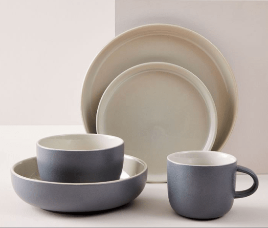 Available in black, Gray Fog (displayed), white, and pink. This collection was designed exclusively for West Elm by Aaron Probyn. It's sold in sets of 4 to 20. The Kaloh Dinnerware Collection isIt's slightly textured with a matte finish on its outside and a contrasting translucent finish on its inside. This collection is casual enough for everyday dining yet elevated in its design to make a striking style statement on special occasions. Get it here.