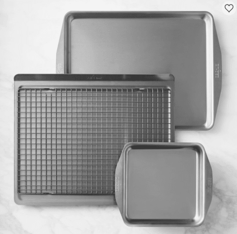 All-Clad is known for its heavy-duty construction and durability. The 4-Piece Essential Bakeware set will last you forever and includes one piece of bakeware many at-home bakers hardly think twice about - the cooling rack.Buy it here.