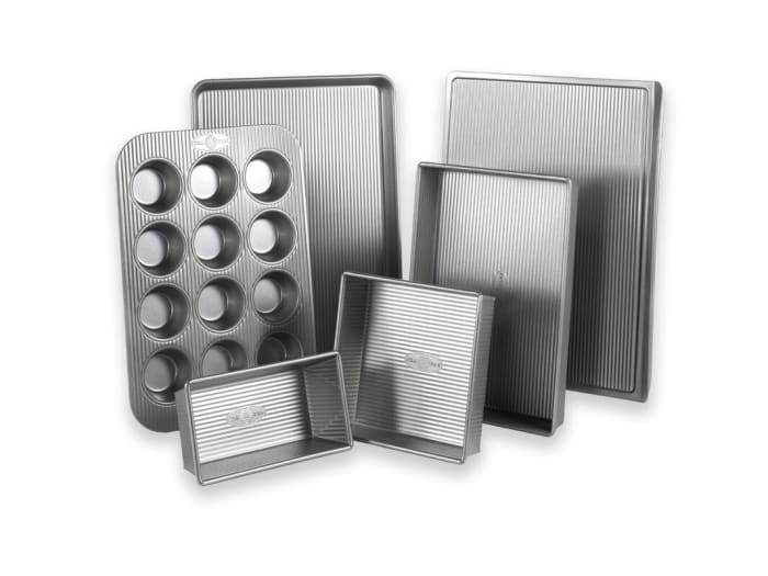 This set has a corrugated surface that supports air circulation for even baking and quick dissolving.  It's also coated with a non-stick silicone surface that is PTFE, PFOA, and BPA free.