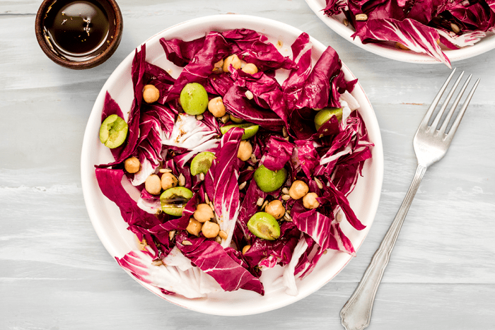 Vegan radicchio salad with green olives, chickpeas and balsamic dressing