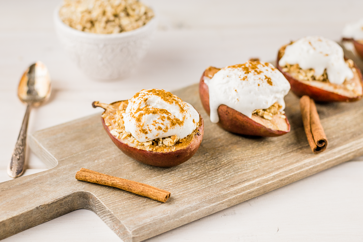 These vegan baked pears with a gluten-free crumble and coconut whipped cream are an elegant and sophisticated dessert fit for autumn and winter gatherings.
