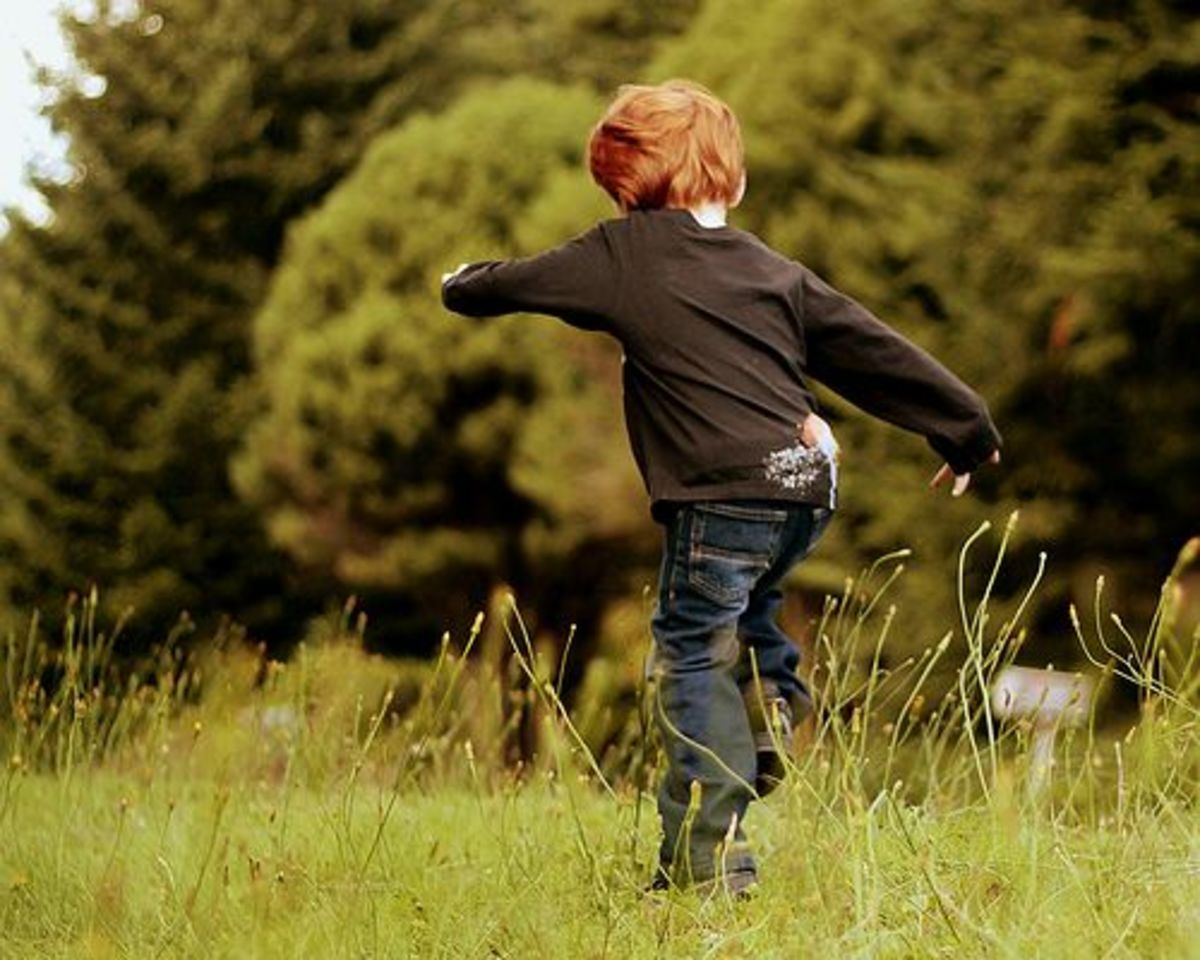 child jumping in the grass