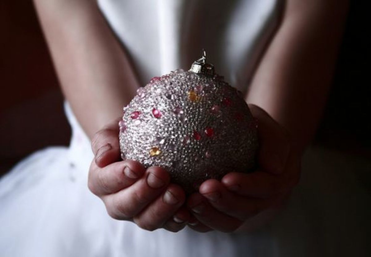 Child holding Christmas ornament