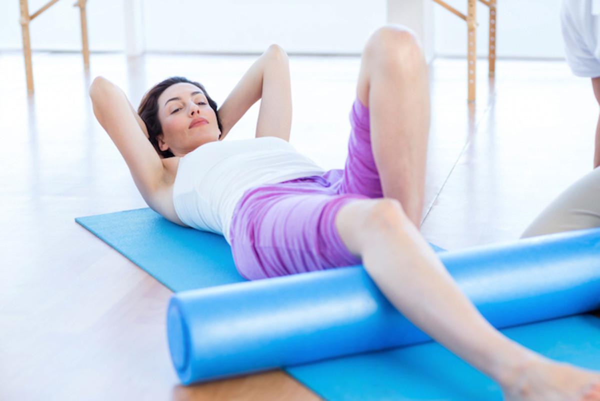 women on exercise mat