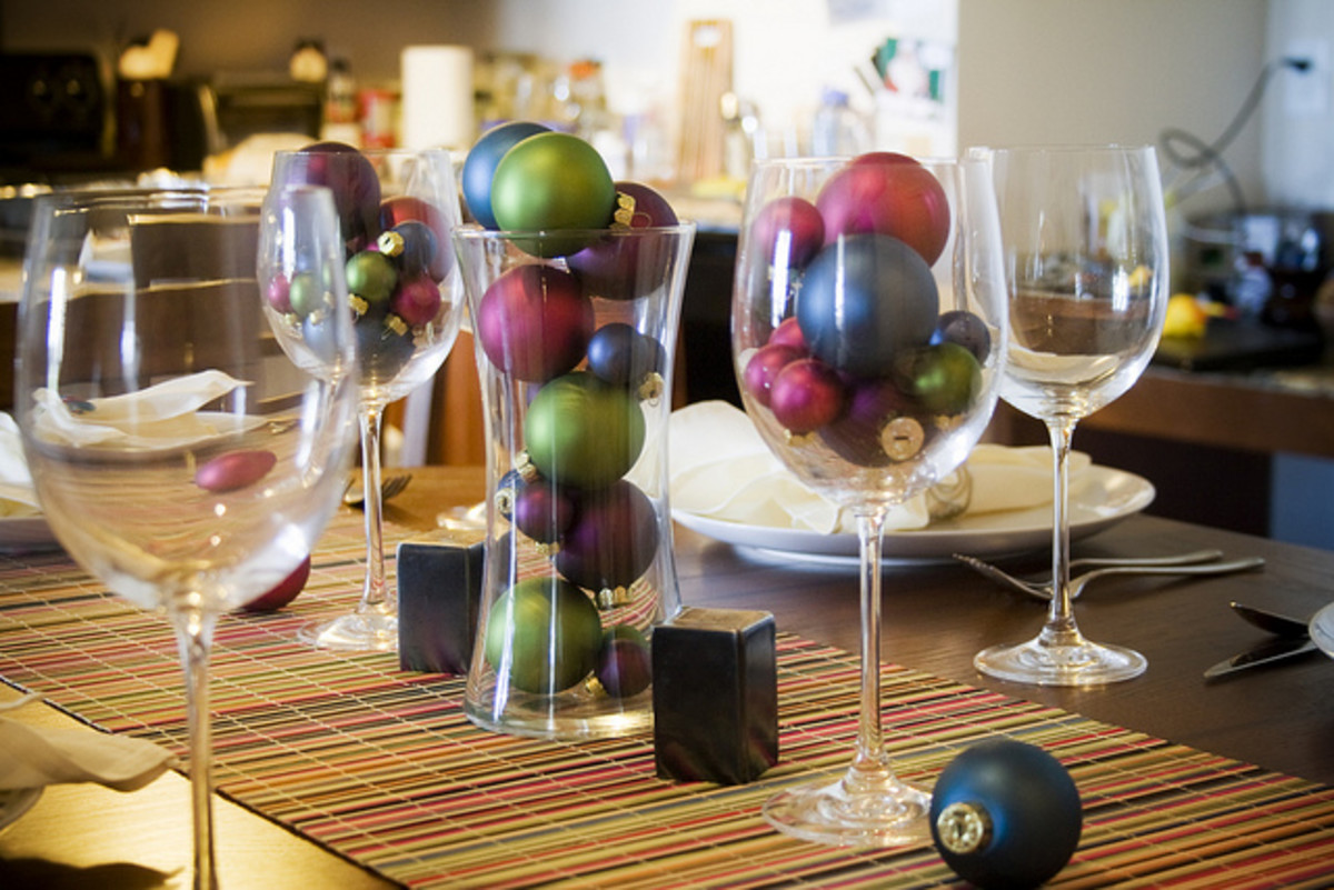 holiday ornaments and wine glasses holiday centerpiece photo