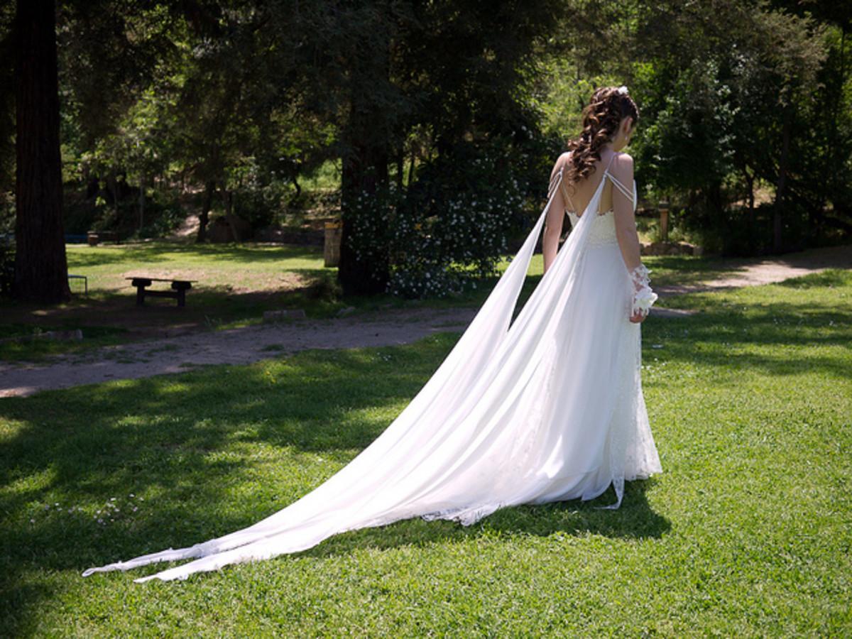 Bride walking outside