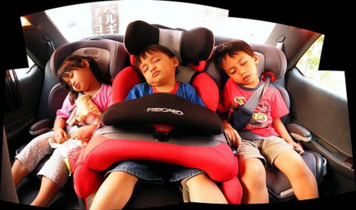 Kids sleeping in car.