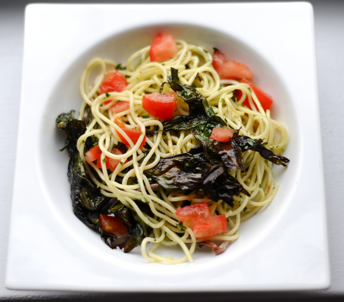 spaghetti with ramps and tomatoes