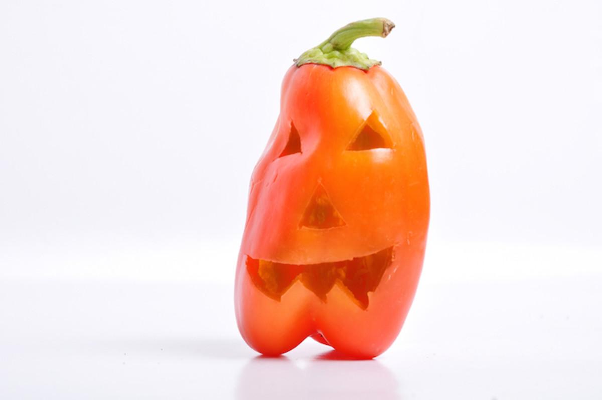 Festive Halloween-Themed Stuffed Red Bell Pepper Jack-O'-Lanterns Recipe