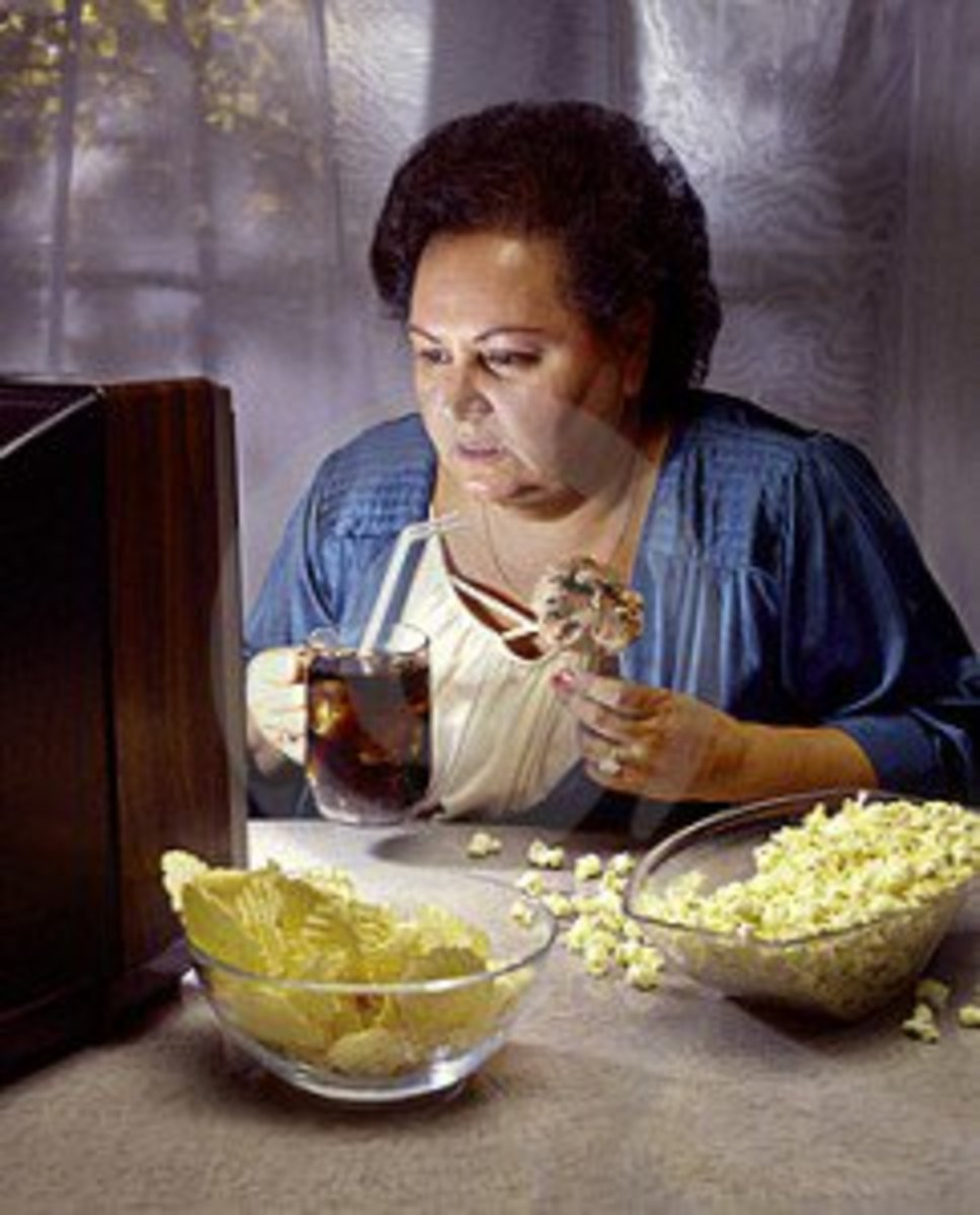heavy-woman-watching-tv-while-eating-junk-food-thumb5939970-242x3002
