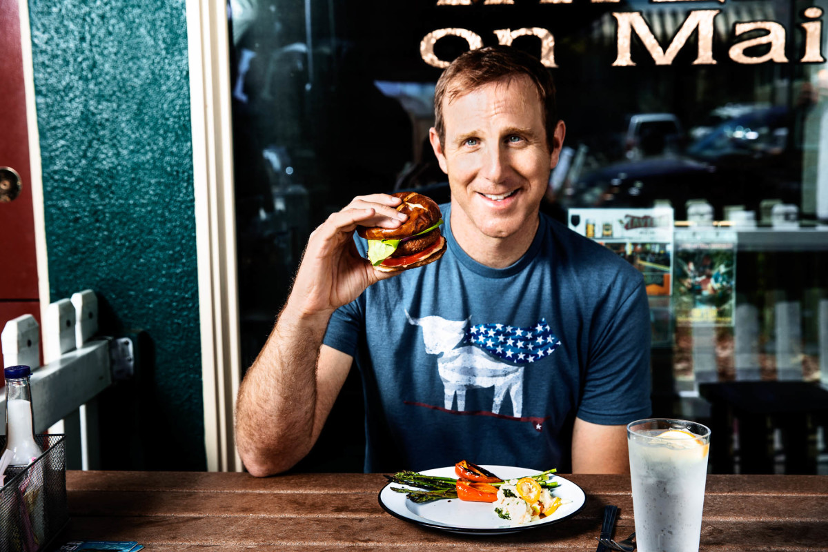 Ethan Brown, Beyond Meat Founder, with the Beyond Burger. Image courtesy of Beyond Meat.
