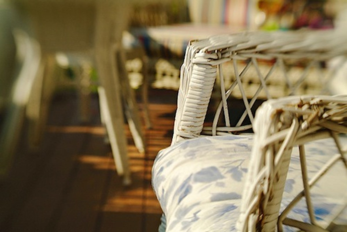 Wicker chair on porch.