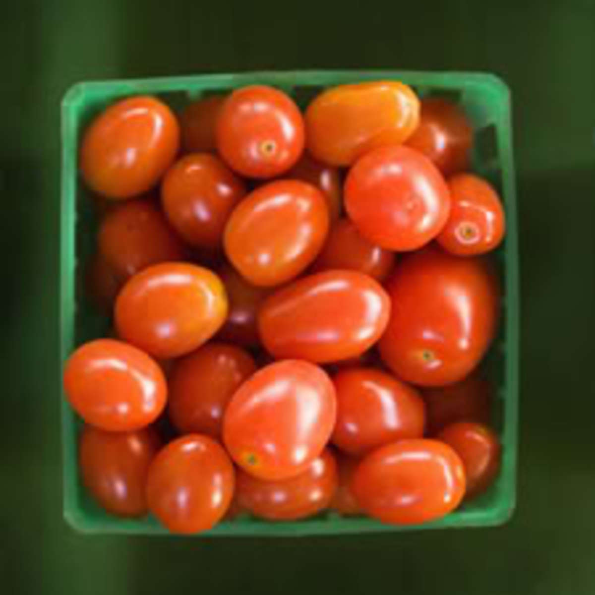 Container of red cherry tomatoes.