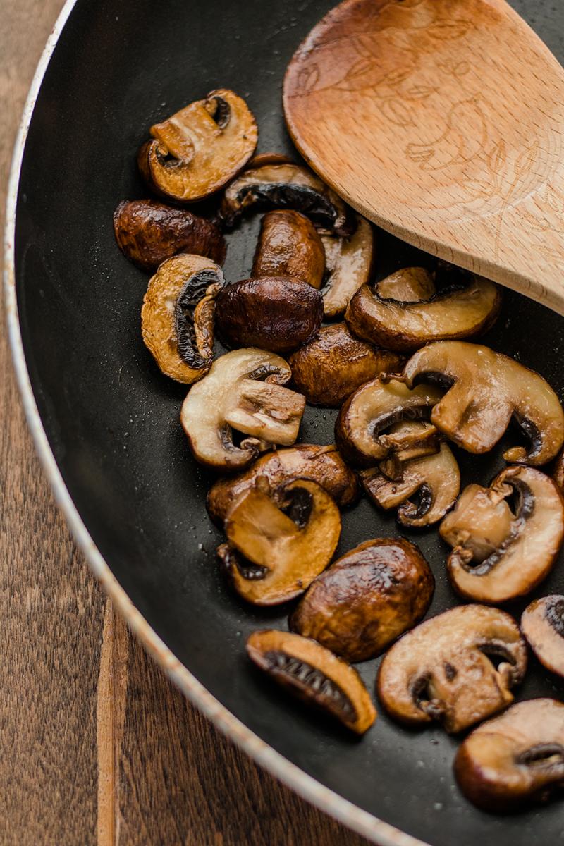 sauteing mushrooms in pan
