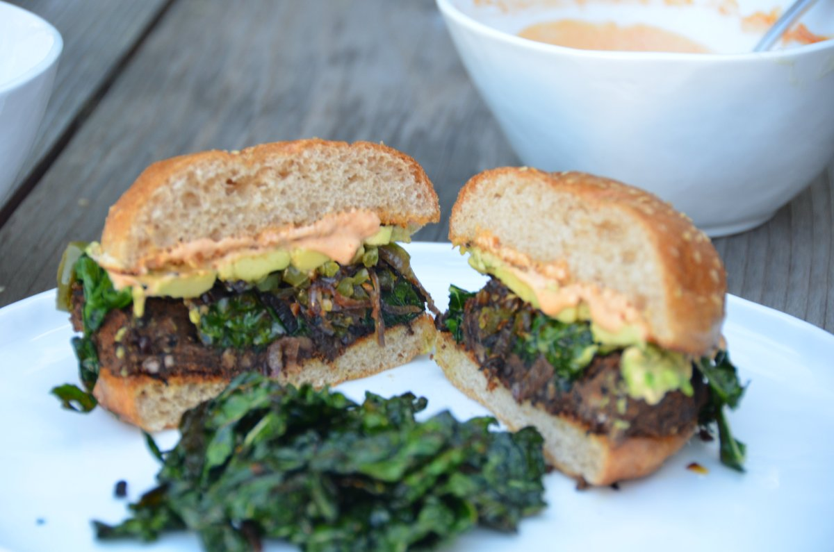 Black Bean Quinoa Burgers with Carmelized Onions, Jalapeños, Avocado and Blistered Kale