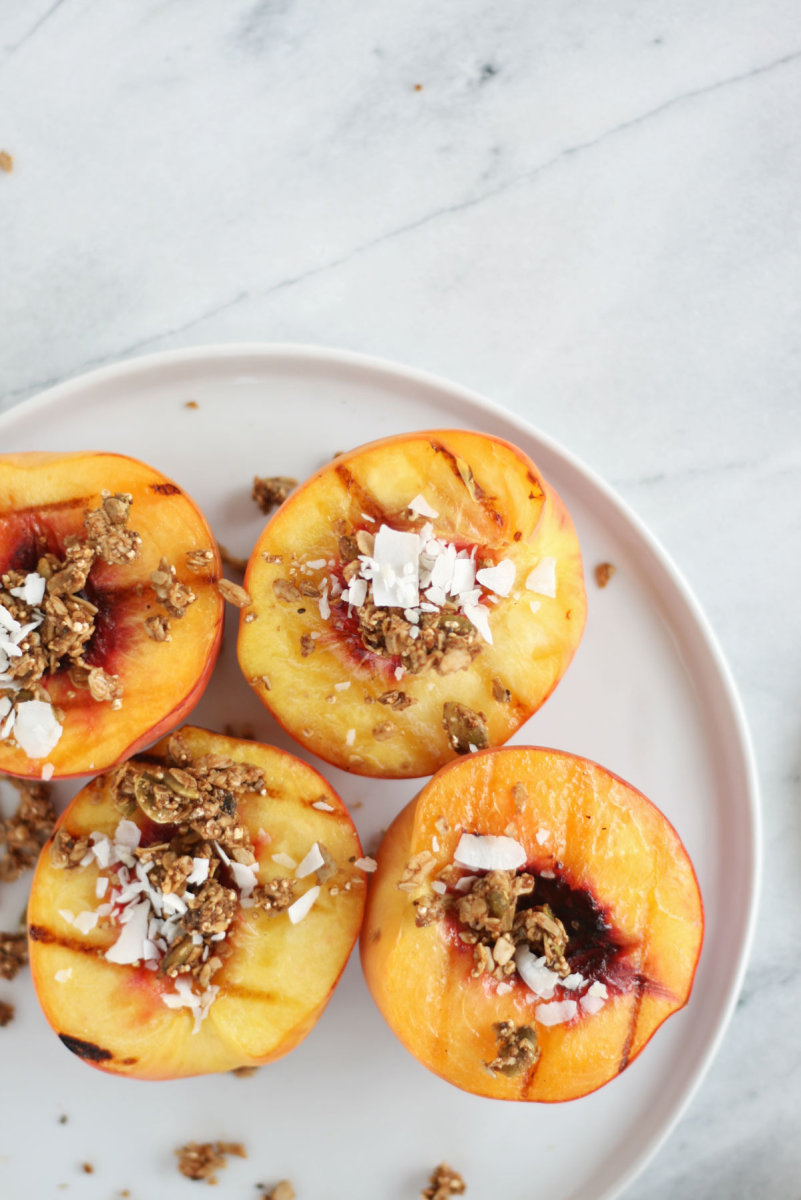grilled peaches with granola and coconut flakes