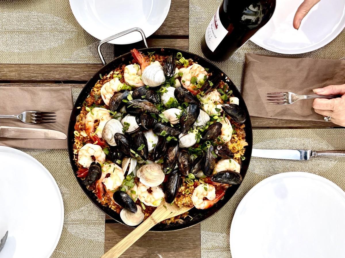 Paella in paella pan on table