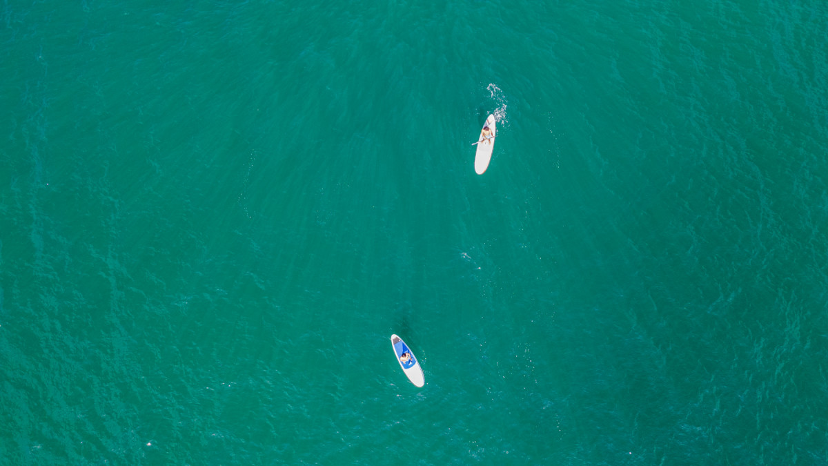 Two stand up paddle boarders enjoying the waters off of Mexico's Costa Careyes.